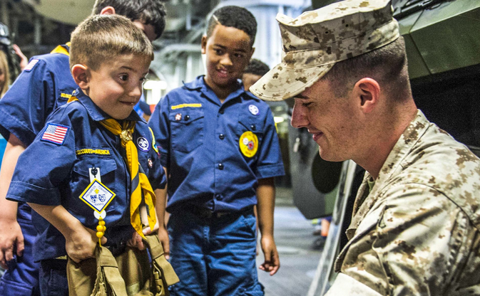 A Boy Scout lifts body armor during a ship tour on the amphibious assault ship Wasp in New Orleans, on Saturday. The Wasp is participating in Fleet Week New Orleans 2015, a weeklong collaboration with the community and ships. | Military Times >>