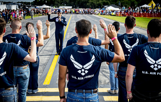 Air Force Maj. Tyler Ellison administers the oath of enlistment to Florida's newest airmen during an air show in Lakeland, Fla. | Military Times >>