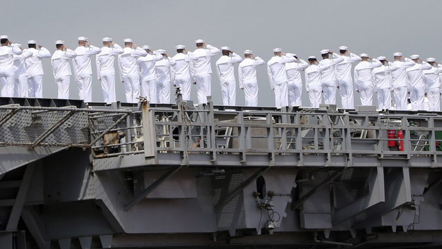 Sailors of USS George Washington salute as they leave the U.S. Navy's Yokosuka base in Yokosuka, Japan. | Military Times >>