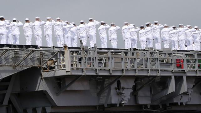 Sailors of USS George Washington salute as they leave the U.S. Navy's Yokosuka base in Yokosuka, Japan. | Military Times >>