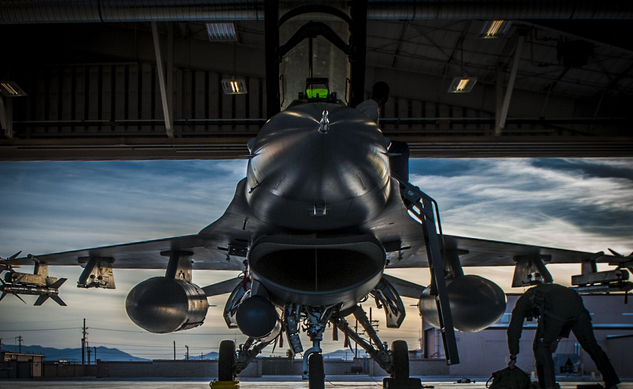 An F-16 Fighting Falcon sits in a hangar prior to departing Holloman Air Force Base, N.M. F-16 students from the 311th Fighter Squadron, a tenant until from Luke Air Force Base, Ariz., are flying night operations as part of their syllabus. | Military Times >>