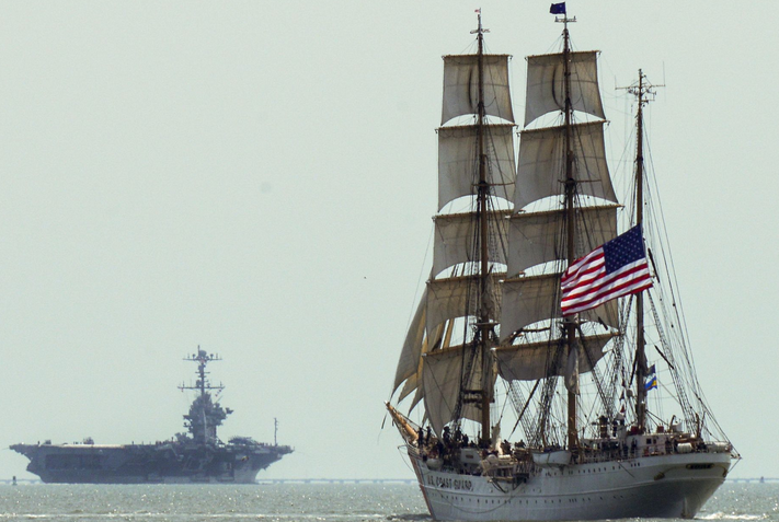 The Coast Guard Cutter Eagle, foreground, sails in the Chesapeake Bay near Norfolk, Va. The Eagle's crew recently participated in the 39th annual Norfolk Harborfest. | Military Times >>