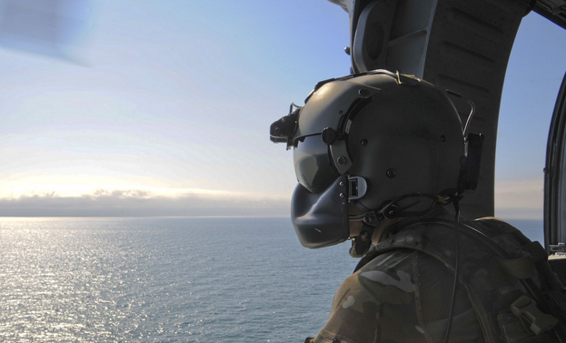 U.S. Air Force Senior Airman Talon Leinbaugh, 66th Rescue Squadron aerial gunner, conducts aerial surveillance in an HH-60G Pave Hawk over the Pacific Ocean during Angel Thunder 2015. | Military Times >>