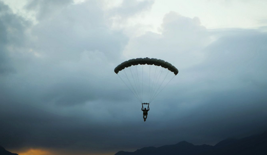 Marine Gunnery Sgt. Eddie Myers, parachute safety officer assigned to Detachment 4th Force Reconnaissance Company, parachutes from a UH-1Y Venom helicopter during airborne insertion training at the flight line aboard Marine Corps Air Station Kaneohe Bay. | Military Times >>