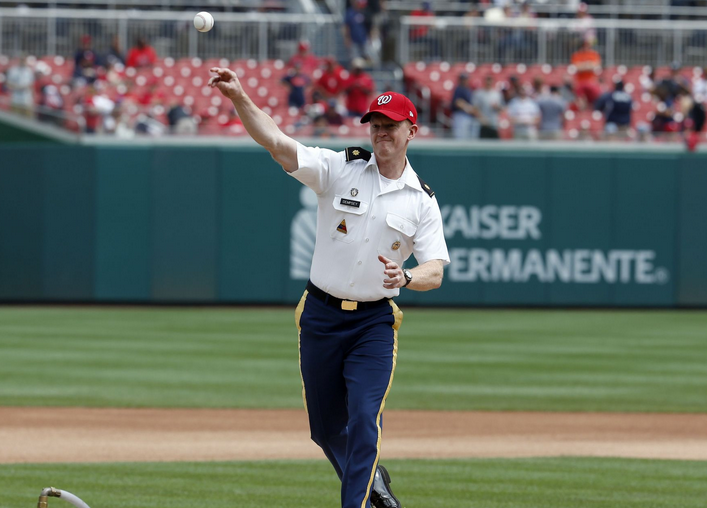 Army Maj. Chris Dempsey throws out a ceremonial first pitch before the baseball game between the Washington Nationals and the San Francisco Giants at Nationals Park in Washington, D.C. | Military Affairs >>