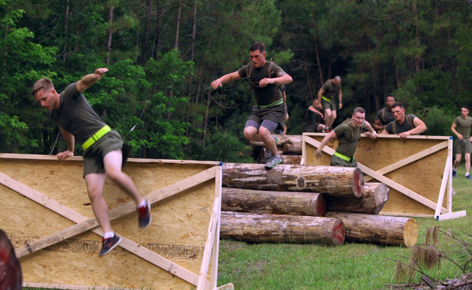 Marines with Marine Wing Support Squadron 274 negotiate obstacles during their inaugural Ironman Challenge at Marine Corps Air Station Cherry Point, N.C. | Military Times >>