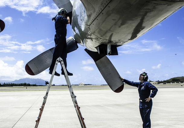 """Aviation Machinist's Mate Airman Alex Cowen, left, and Aviation Machinist's Mate 2nd Class Tamatha Shulmerich, assigned to the """"Golden Eagles"""" of Patrol Squadron (VP) 9, troubleshoot engine four on a P-3C Orion maritime patrol aircraft.   Military Times >>"""