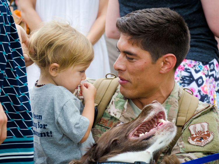 Capt. Trevor Sutherland, a pilot in the 165th Airlift Squadron, embraces his family during a homecoming ceremony at the Kentucky Air National Guard Base in Louisville, Ky.  | Military Times >>