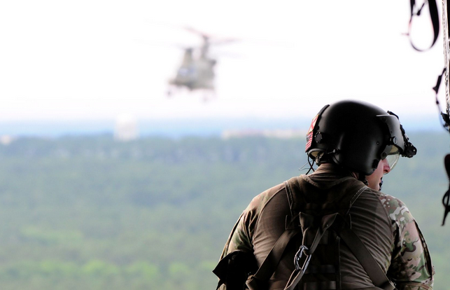 A paratrooper from the 82nd Combat Aviation Brigade, 82nd Airborne Division scans the skies while aboard a CH-47 Chinook at Fort Bragg, N.C. | Military Times >>