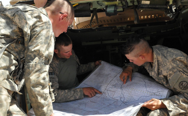Idaho Army National Guard soldiers Sgt. Jeffrey Hanson, Sgt. Jordan Egbert and Spc. Connor Mason, combat engineers with the 116th Cavalry Brigade Combat Team, review routes on a field map at the National Training Center at Fort Irwin, Calif. | Military Times >>