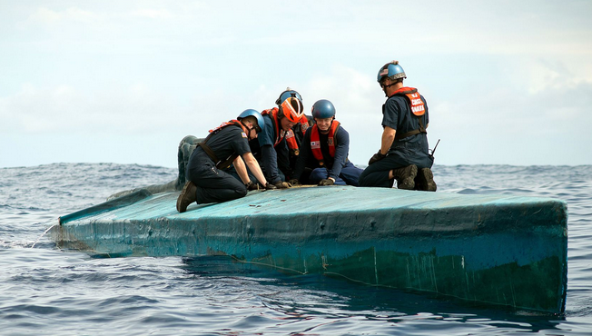 A Coast Guard Cutter Stratton boarding team member inspects the bridge of a self-propelled semi-submersible interdicted in international waters off the coast of Central America. | Military Times >>