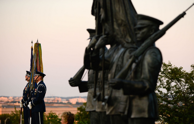 Members of the Air Force Honor Guard stand by to present the colors during a wreath-laying ceremony commemorating the 70th anniversary of the end of World War II. | Military Times >>