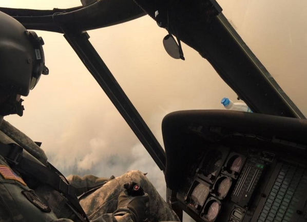 A Washington National Guard Black Hawk pilot looks out over the Cougar Creek fire near Mt. Adams on Monday while helping battle the blaze. | Military Times >>