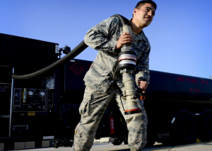 Airman 1st Class Sergio Fortich, 31st Logistics Readiness Squadron petroleum oils and lubricants mobile distribution operator, pulls a hose from an R-11 refueling truck on Wednesday at Aviano Air Base, Italy. | Military Times >>