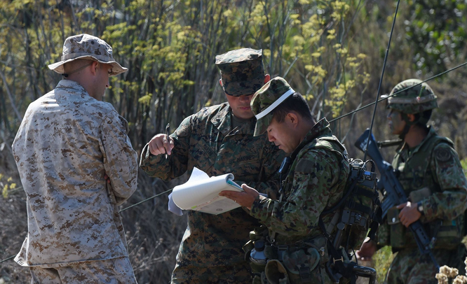 U.S. Marines and Japanese soldiers consult a map during an amphibious landing operation with U.S. forces and the Japan Maritime Self-Defense Force at the Dawn Blitz 2015 exercise in Camp Pendleton, Calif. | Military Times >>