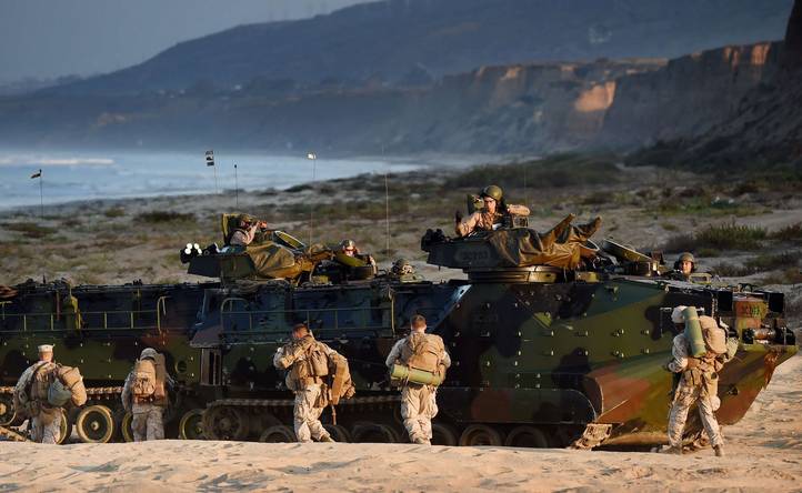 Marines take their positions during an amphibious landing operation with the Japan Maritime Self-Defense Force at the Dawn Blitz 2015 exercise in Camp Pendleton, Calif. | Military Times >>