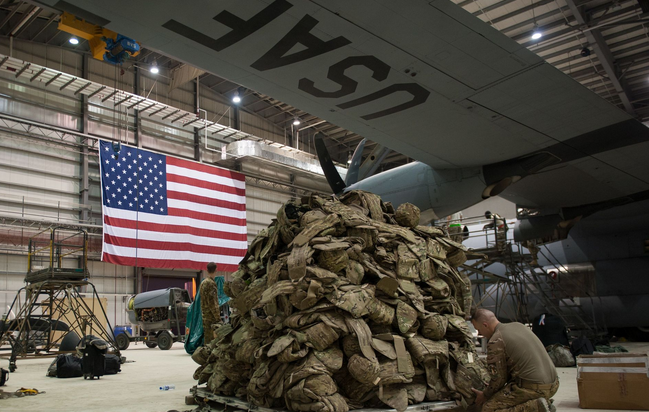 An airman assigned to the 774th Expeditionary Airlift Squadron prepares a pallet before it is loaded onto a C-130J Super Hercules aircraft at Bagram Air Field, Afghanistan. | Military Times  >>