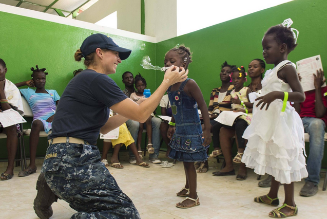 Lt. Ashley Rohrman, a registered nurse, interacts with patients at a medical site established at St. Luc Hospital in Port Au Prince, Haiti, during Continuing Promise 2015. | Military Times >>