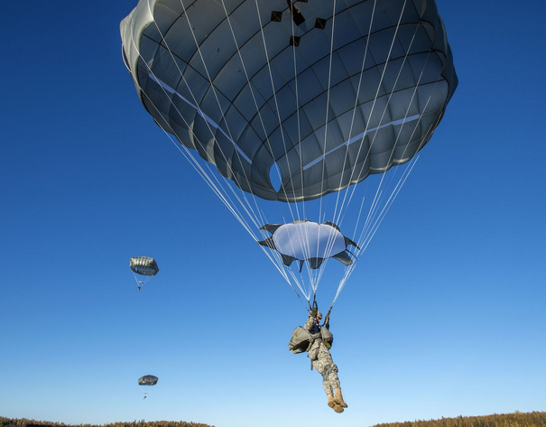 Army Spc. Conner Cota, a native of Hallsville, Mo., assigned to E Company, 6th Brigade Engineer Battalion, descends while conducting helicopter jump training over Malemute drop zone, Joint Base Elmendorf-Richardson, Alaska. | Military Times ><figcaption id=