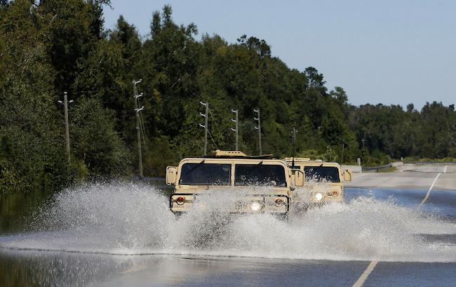 National Guard Humvees plow through flood waters on Highway 377 near Kingstree, S.C. | Military Times >>