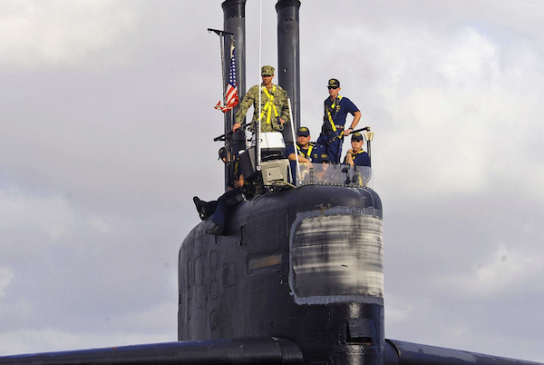 Cmdr. Donald Tenney (right), commanding officer of the Los Angeles-class fast-attack submarine Albuquerque, stands on the bridge as the boat prepares to depart San Diego for the final time. Albuquerque held an inactivation ceremony at Naval Base Point Loma, marking the its final public event celebrating more than 32 years of service. | Military Times >>