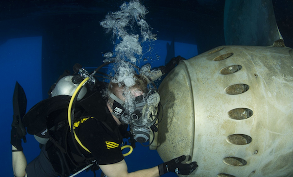 Navy Diver 2nd Class David Close, assigned to Commander Task Group (CTG) 56.1, conducts a ship's husbandry dive to inspect running gear. CTG 56.1 conducts mine countermeasures, explosive ordnance disposal, salvage-diving, and force protection operations throughout the U.S. 5th Fleet area of operations. | Military Times >>