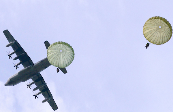 Paratroopers assigned to the 2nd Battalion, 503rd Infantry Regiment, 173rd Airborne Brigade, and Italian Army soldiers from Folgore Brigade are conducting an airborne operation from a C-130 aircraft during a combined air assault and seizure of Lidia Drop Zone, Siena, Italy, during Mangusta 15 exercise. | Military Times >>