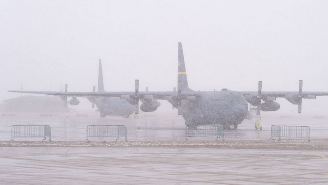 Two C-130H Hercules aircraft assigned to the 153rd Airlift Wing, Wyoming Air National Guard, are parked on the ramp in Cheyenne, Wyoming. High winds and cold temperatures brought snow from the west and temporarily ceased flying operations at the 153rd Airlift Wing. | Military Times >>