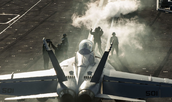 "Sailors direct an EA-18G Growler, assigned to the ""Patriots"" of Electronic Attack Squadron (VAQ) 140, on the flight deck of aircraft carrier Harry S. Truman. 