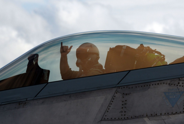 First Lt. Brady Amack, 95th Fighter Squadron F-22 Raptor pilot, waves before takeoff from Tyndall Air Force Base, Fla., flight line during a training mission. | Military Times >>