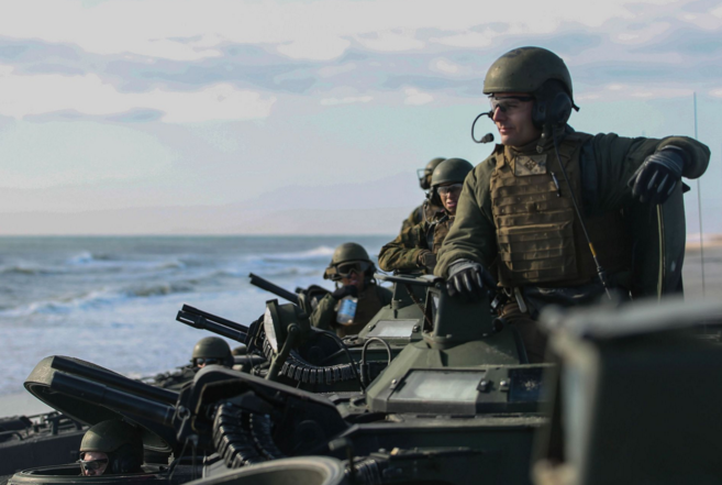 A Marine with Alpha Company, 2nd Assault Amphibian Battalion, awaits the order to lock down the hatches as the unit prepares to conduct company-level beach operations on Camp Lejeune, N.C. | Military Times >>