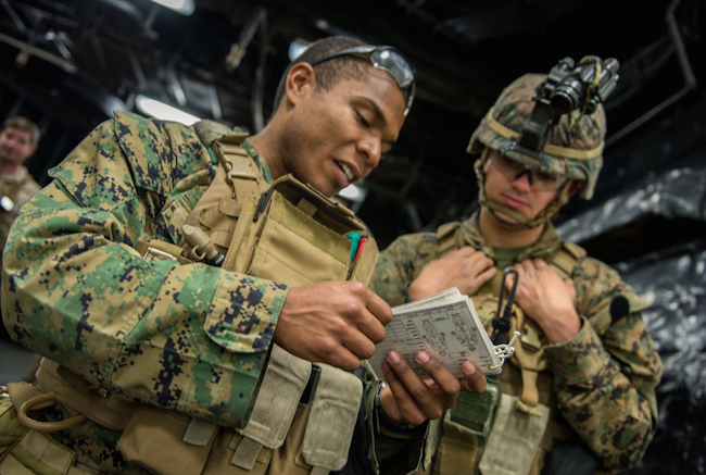 Hospital Corpsman 3rd Class Josef Dawson discusses first-aid procedures to LCpl. Joseph Lampoi on Saturday before a Long Range Amphibious Raid onboard the amphibious assault ship Boxer. | Military Times >>