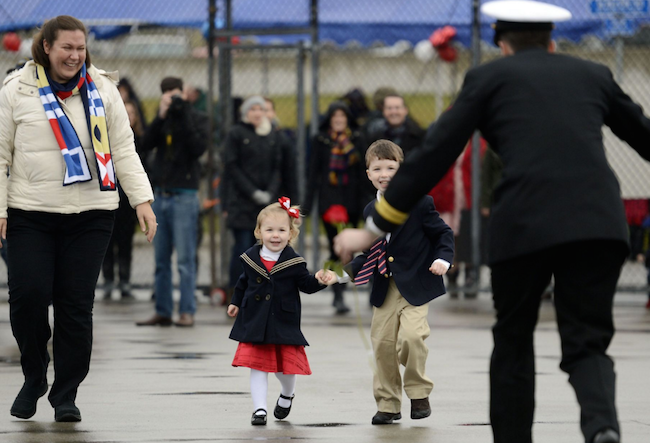 Navy Lt. Gregory Storer, right, races to greet his children, Mary and John, and wife, Elizabeth, as the attack submarine Hartford returns to the U.S. Navy Submarine Base in Groton, Conn., on Dec. 18, following a six-month deployment to the European Command Areas of Responsibility. | Military Times >>