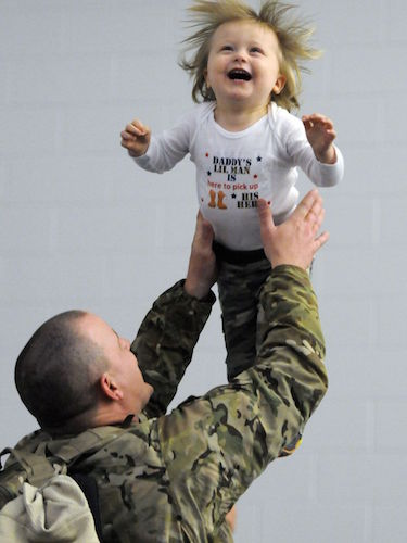 Sgt. First Class Gary Foran Jr. tosses his 18-month old son Logan into the air after arriving at the National Guard's Windsor Locks Army Aviation Readiness Center on Wednesday in Windsor Locks, Conn. | Military Times >>