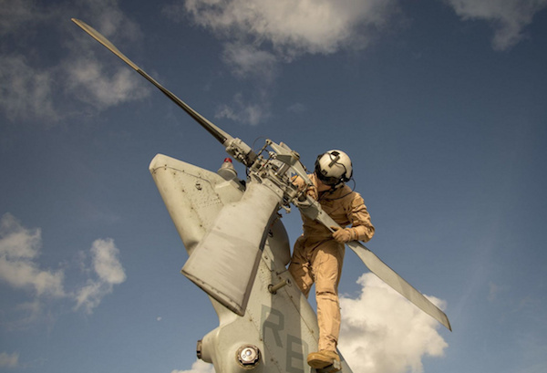 Hospital Corpsman 3rd Class Curt Hanson, assigned to Helicopter Sea Combat Squadron (HSC) 25, performs a pre-flight on an MH-60S Seahawk helicopter prior to a photo exercise at Andersen Air Force Base, Guam. | Military Times >>