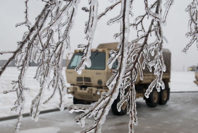 Ice covered trees, parking lots and the ground while light medium tactical vehicles are staged at the Oklahoma Highway Patrol station at Perry, Oklahoma. | Military Times >>