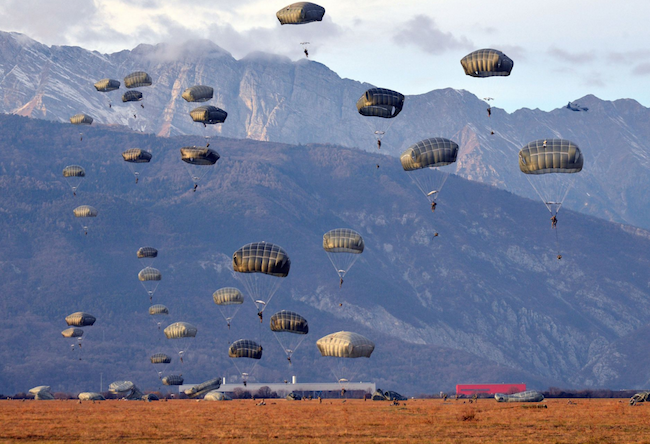 U.S. paratroopers assigned to the 173rd Brigade Support Battalion, exit a U.S. Air Force 86th Air Wing C-130 Hercules at Juliet Drop Zone in Pordenone, Italy. | Military Times >>