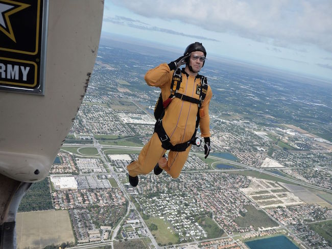 A member of the Golden Knights demonstration team salutes as he exits a Fokker C-31A Troopship during a training jump over Homestead Air Reserve Base, Fla. | Military Times >>