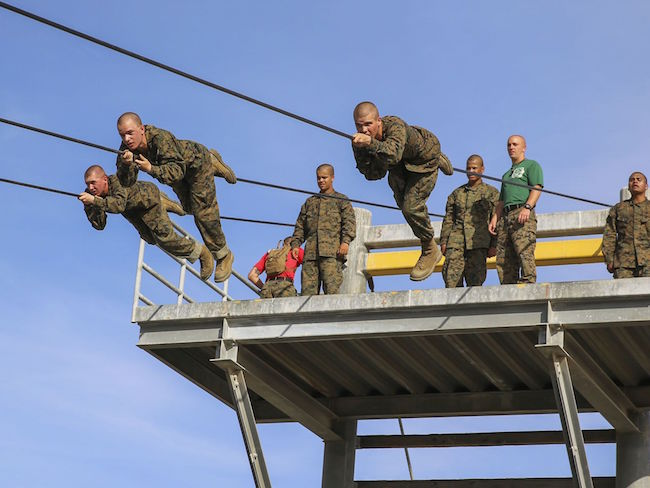 Recruits of Alpha Company, 1st Recruit Training Battalion, participate in the Slide for Life obstacle during Confidence Course II at Marine Corps Recruit Depot San Diego. Lance Cpl. Angelica Annastas/Marine Corps | Military Times >>