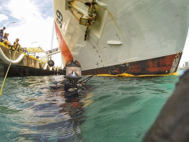Petty Officer 2nd Class Nicholi Zapara, a diver with the Regional Dive Locker Pacific, surfaces from a hull inspection on USCGC Alex Haley (WMEC 39) while docked in Honolulu.  Michael Perrault/Coast Guard | Military Times >>