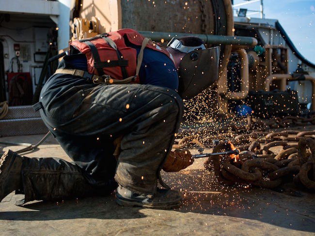Seaman Conor Magill, a buoy deck crewmember aboard the Coast Guard cutter Katherine Walker, cuts chain with a torch aboard the cutter while transiting the New York Harbor. Petty Officer 3rd Class Frank Iannazzo-Simmons/Coast Guard   Military Times >>