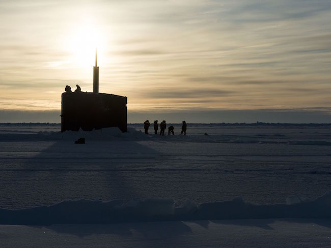 The submarine Hampton surfaces through the ice in the Arctic Circle on March 14 during Ice Exercise 2016. ICEX is a five-week exercise designed to research, test and evaluate operational capabilities in the region.  MC2 Tyler Thompson/Navy | Military Times >>