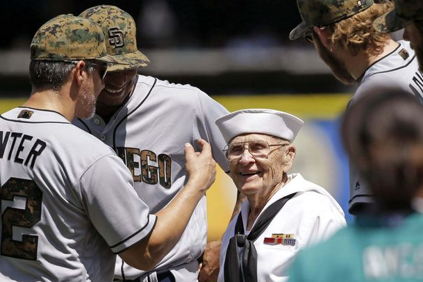 World War II veteran Burke Waldron greets members of the San Diego Padres before a baseball game against the Mariners on May 30, 2016, in Seattle. Waldron threw out the ceremonial first pitch as part of Memorial Day ceremonies at the game.  Elaine Thompson/AP | Military Times >>
