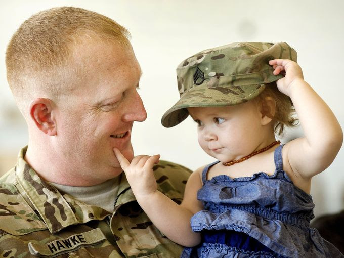 Army Staff Sgt. Matthew Hawke enjoys a moment with his daughter Brooklyn during a sending off ceremony for him and members of the Nebraska Army National Guard, based out of Lincoln, Neb., on June 3, 2016. While deployed the soldiers will be responsible for conducting aeromedical evacuation support operations. Their mission is expected to last approximately one year. | Military Times >>