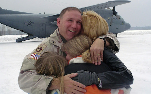 US Army (USA) Specialist First Class (SPC) Manifold hugs his family after a long deployment in Iraq (IRQ) with the 1440th Engineer detachment, of the Michigan Army National Guard (MIARNG).
